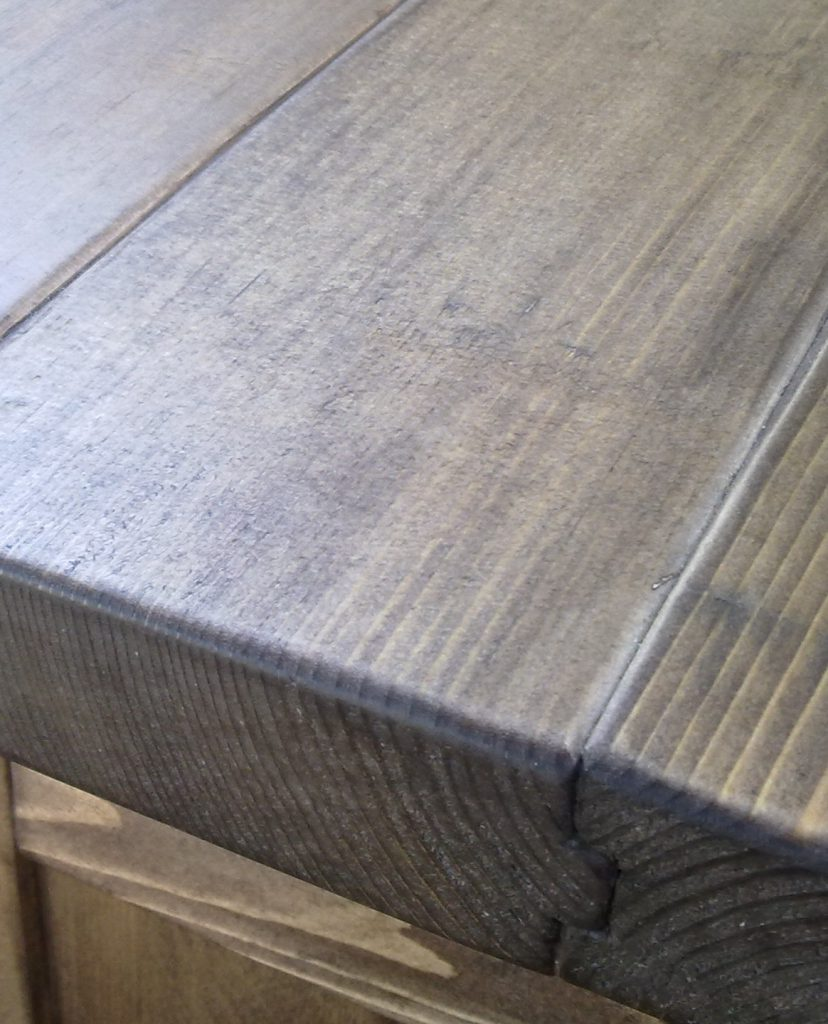 Detail of stained Siberian Spruce side board top