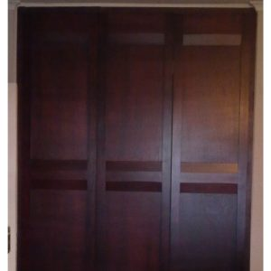 Doors for a built-in wardrobe with flat panels in stained Okoume
