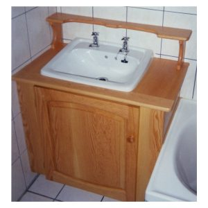 Bathroom cabinet in Oregon Pine fitted around wash basin