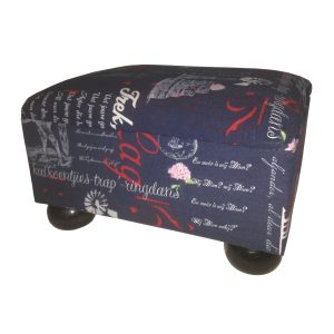 Upholstered foot stool with bun feet