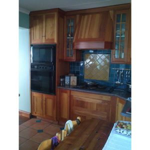 Kitchen cabinets in Oregon Pine and Cypress with a Redwood breakfeast counter