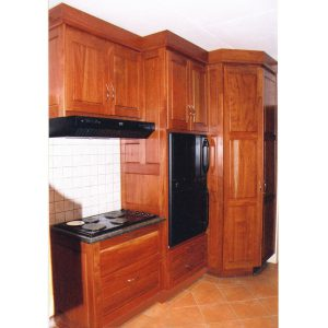 Kitchen cabinets in African Rosewood with lots of drawers