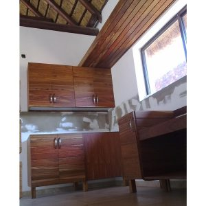 Kitchen cabinets on wooden legs in Kiaat