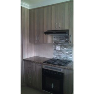 Kitchen cabinets in woodgrain melamine
