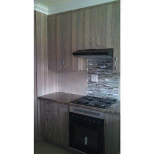 Kitchen cabinets in woodgrain melamine