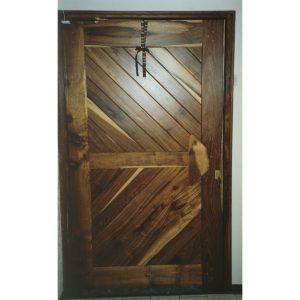 Pivot front door with herringbone panels in Kiaat