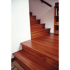 Staircase, landing and wall mounted hand rail in stained Saligna