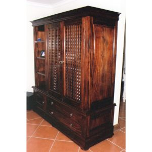 Colonial style TV cabinet with lattice pocket doors, drawers and open shelves in African Mahogany