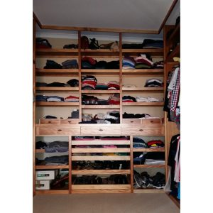 Walk-in closet with pull-out shelves and pull-out dressing mirror in Okoume wood and veneer