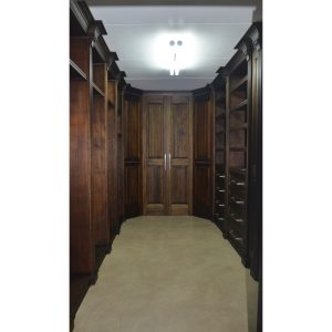 Walk-in closet with hang space, shelves, drawers and pull-out shoe racks in Mahogany finish