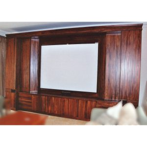 Wall unit with pull-out media storage and projector screen in African Mahogany