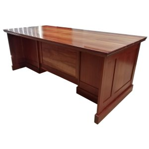 1,7m Pedestal desk in Rhodesian Teak with four drawers and one door.