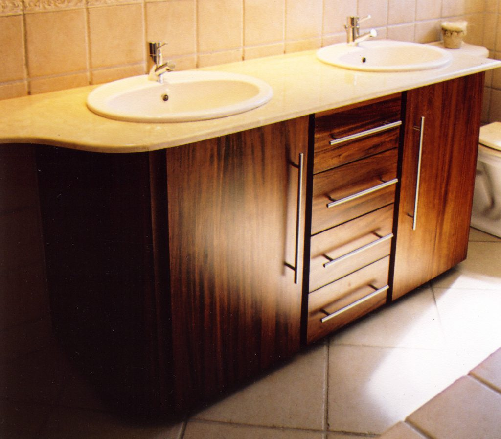 Bathroom cabinet in African Mahogany with two doors and four drawers. #0415